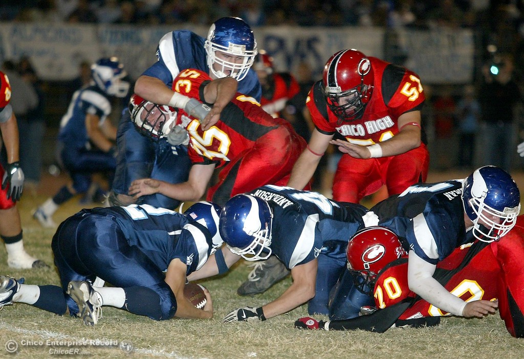 . PV High\'s recovers it\'s own fumble against Chico High in the first quarter in the 2006 Almond Bowl XXXVI football game at University Stadium Friday night. - halley photo 10/13/06