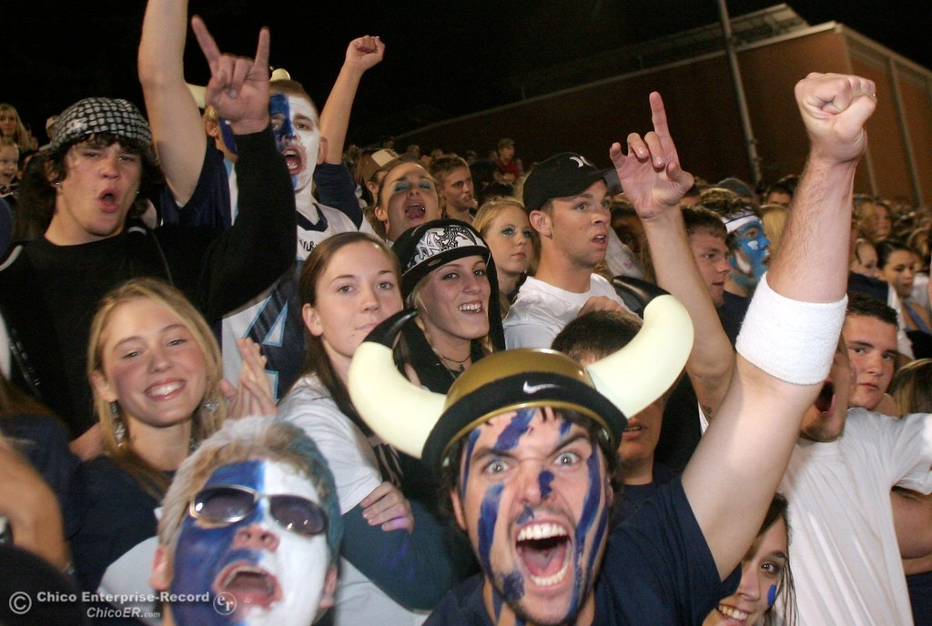 . PV\'s fans Eric Miller, 17 (bottom left) and Ryan Fehling, 17 (bottom right) cheer on football against Chico High in the 2006 Almond Bowl XXXVI football game at University Stadium Friday night. - halley photo 10/13/06
