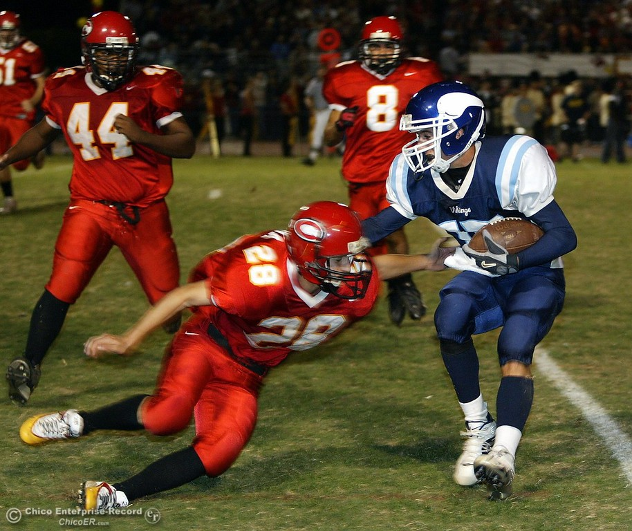. PV\'s #15 Blake Page escapes the tackle from Chico\'s #28 Tony Reyna near the 10yr line as #44 Trevor Beck and #8 Zane Zavala came in to make the tackle during the Almond Bowl Friday - halley photo 10/14/05