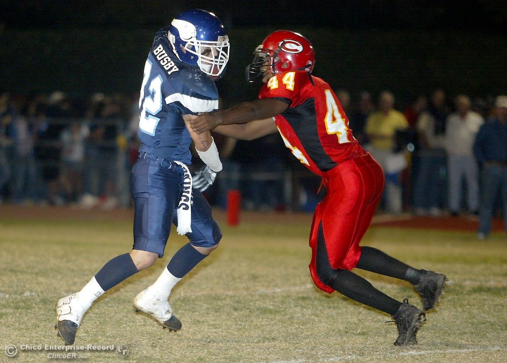 . PV High\'s #32 Evan Busby (left) breaks the tackle from Chico High\'s #44 Doug Osby (right) to run it in for PV firstdown near the 30yrd line with about 6:00 remaining in the first quarter in the 2006 Almond Bowl XXXVI football game at University Stadium Friday night. - halley photo 10/13/06
