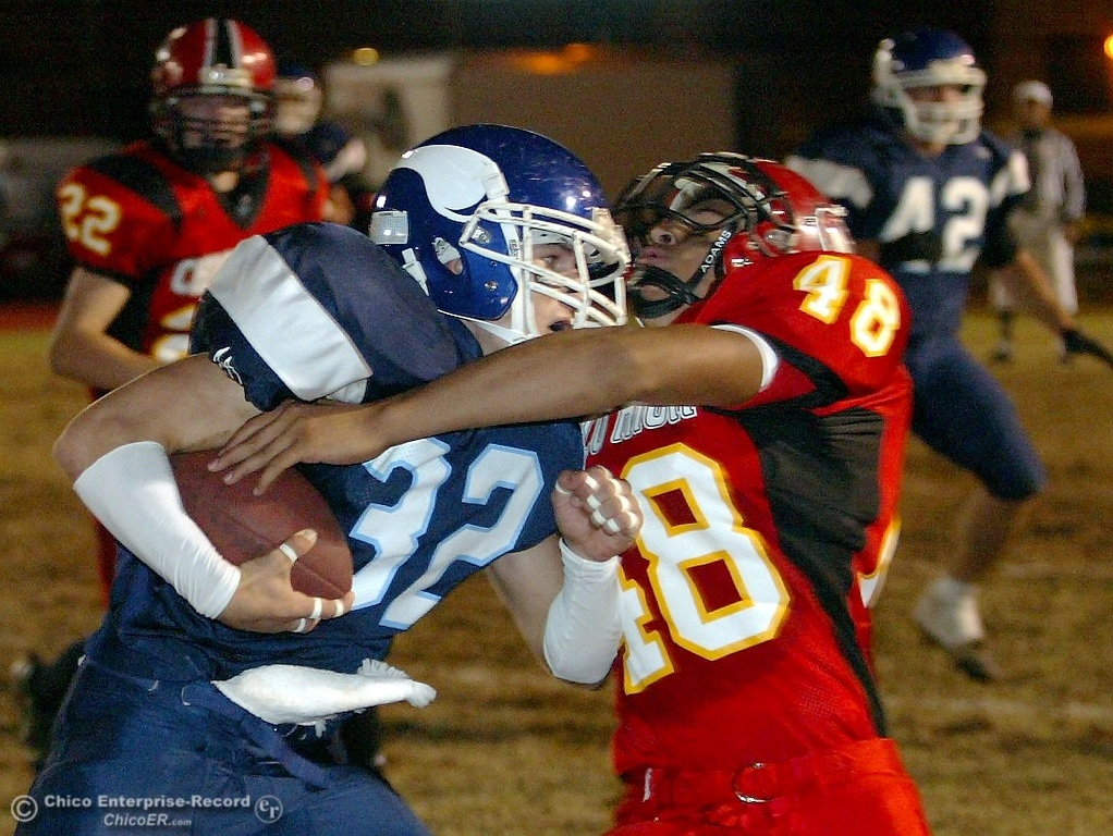 . Pleasant Valley High\'s #32 Evan Busby (left) slams into Chico High\'s #48 Andrew Perlinger (right) with about 10:25 remaining in the first quarter of their Almond Bowl XXXVII football game at CSUC University Stadium on Friday, October 12, 2007 in Chico, CA.  (Jason Halley/Chico Enterprise-Record)