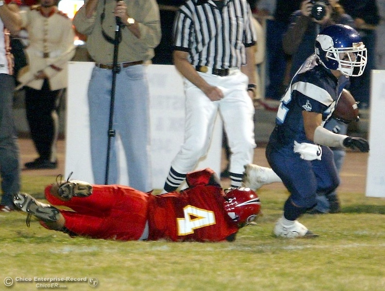 . PV High\'s #32 Evan Busby (right) is tripped up near the 10yrd line by Chico High\'s #4 Andrew Medearis (left) with 0:33 remaining in the second quarter in the 2006 Almond Bowl XXXVI football game at University Stadium Friday night. - halley photo 10/13/06