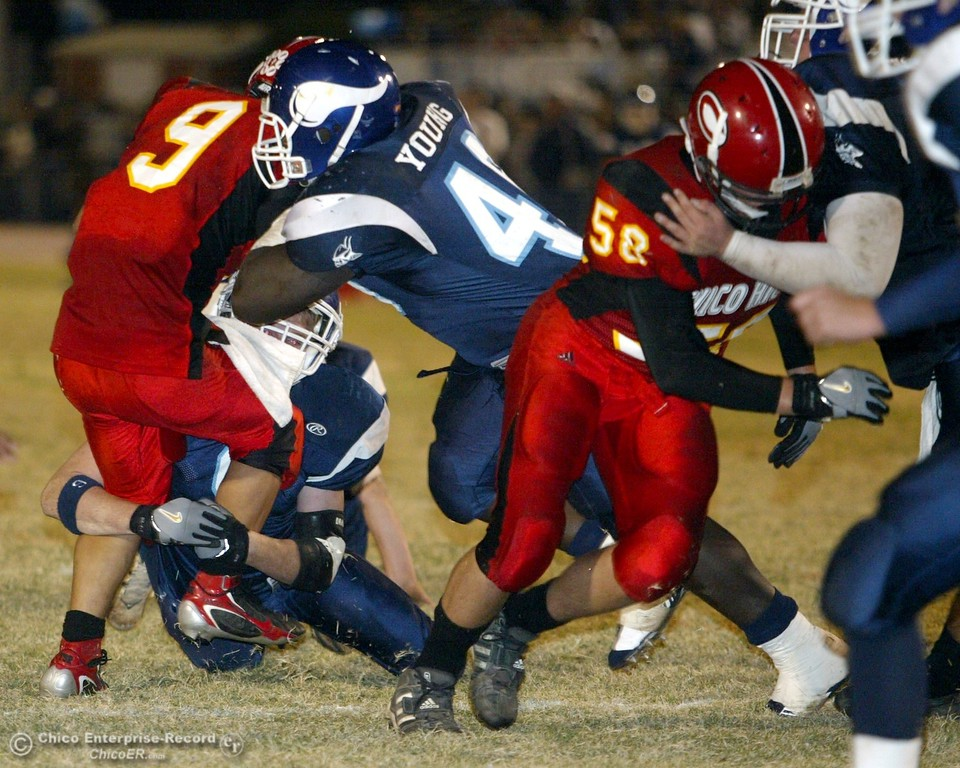 . Chico High\'s #9 Luis Santos (right) rushes near the 10yrd line as he is tackled by PV with about 3:10 remaining in the second quarter in the 2006 Almond Bowl XXXVI football game at University Stadium Friday night. - halley photo 10/13/06