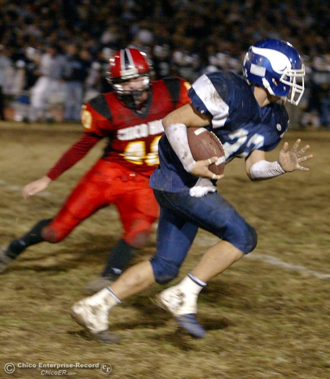 . Pleasant Valley High\'s #32 Evan Busby (right) rushes against Chico High\'s #40 Weston Skillicorn (left) with about 1:20 remaining in the second quarter of their Almond Bowl XXXVII football game at CSUC University Stadium on Friday, October 12, 2007 in Chico, CA.  (Jason Halley/Chico Enterprise-Record)