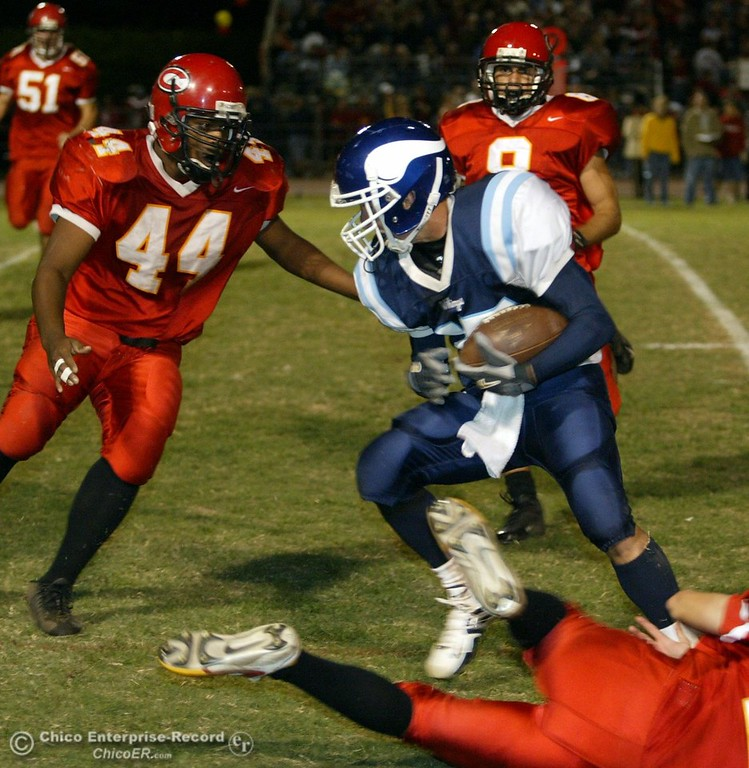 . PV\'s #15 Blake Page escapes the tackle from Chico\'s #28 Tony Reyna (bottom right) near the 10yr line as #44 Trevor Beck and #8 Zane Zavala came in to make the tackle during the Almond Bowl Friday - halley photo 10/14/05