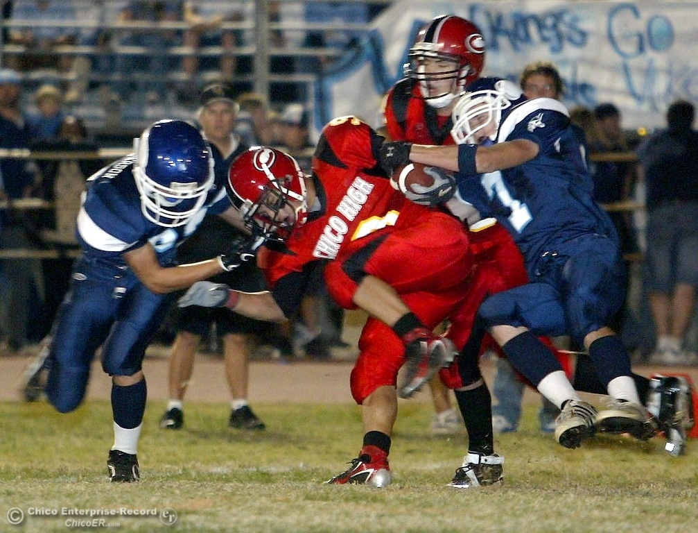 . Chico High\'s #9 Luis Santos (center) is tackled by PV High\'s ____(left) and #7 Michael Deel (right) with about 0:50 remaining in the first quarter in the 2006 Almond Bowl XXXVI football game at University Stadium Friday night. - halley photo 10/13/06