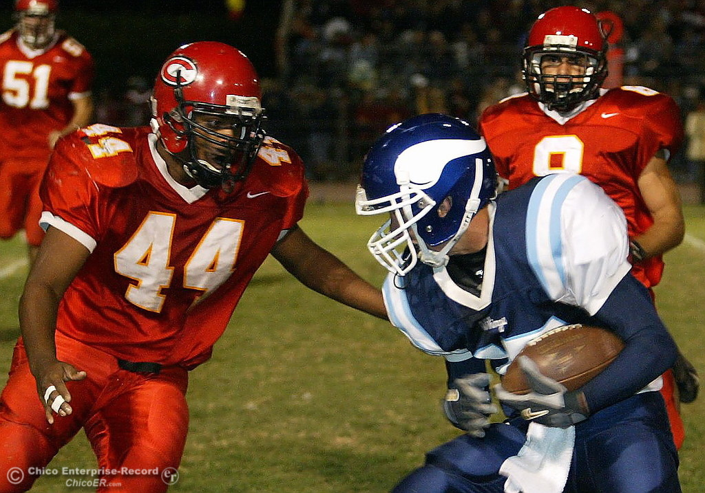 . PV\'s #15 Blake Page escapes the tackle from Chico\'s #28 Tony Reyna (not shown) near the 10yr line as #44 Trevor Beck and #8 Zane Zavala came in to make the tackle during the Almond Bowl Friday - halley photo 10/14/05