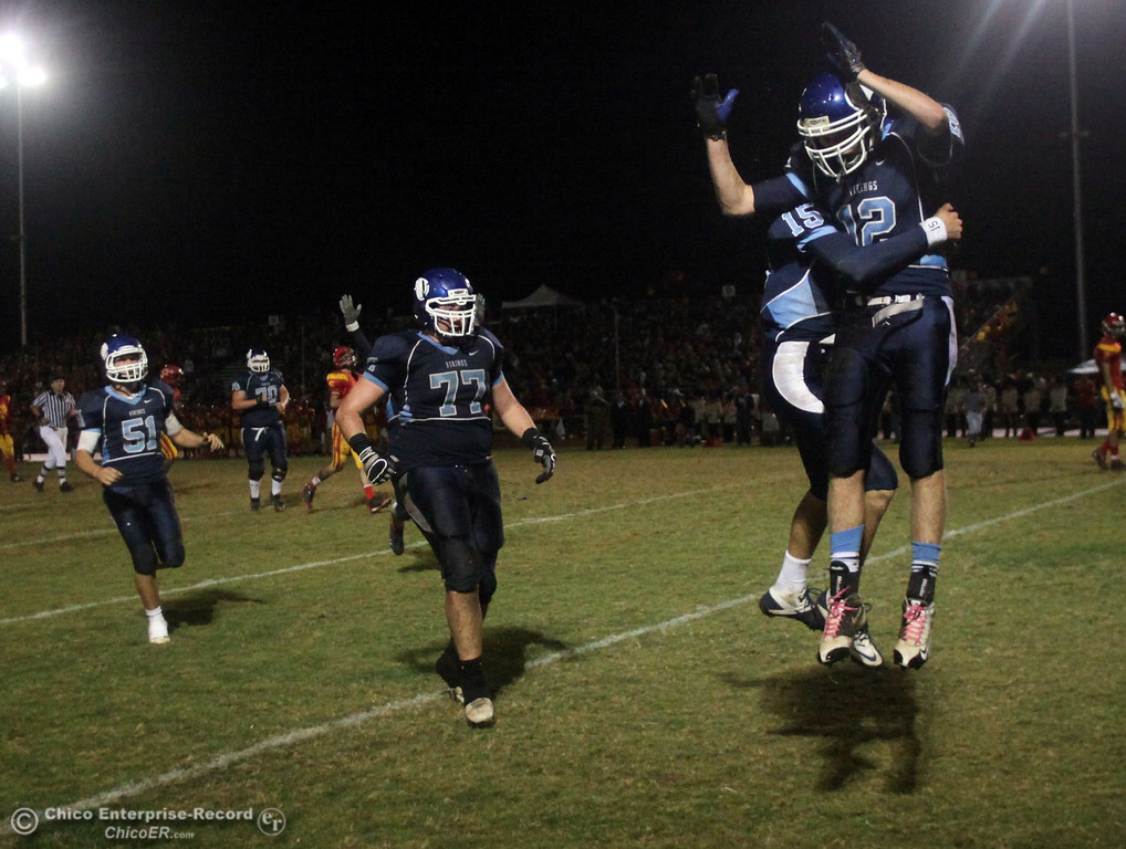 . Pleasant Valley High\'s #12 Chase Drews (right) celebrates a score with #15 Will Christensen after Drews laid out for a completed catch in the end zone to score a touchdown against Chico High in the second quarter of their Almond Bowl football game at CSUC University Stadium Friday, October 22, 2010 in Chico, Calif.