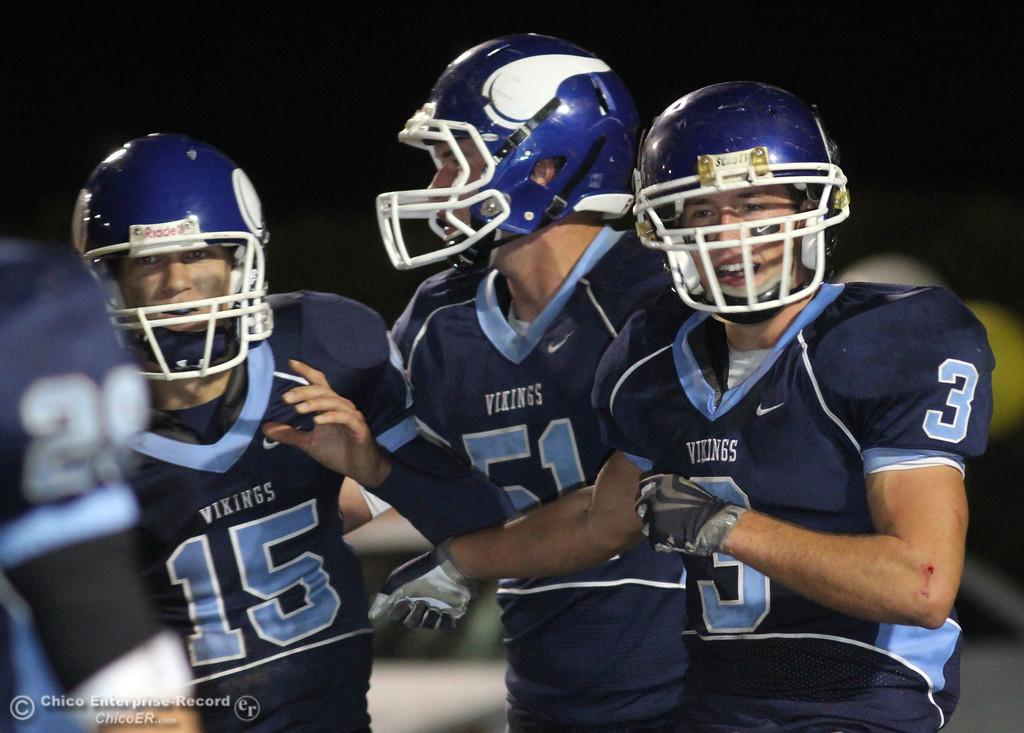 . Pleasant Valley High\'s #15 Will Christensen, #51 Sean Oshea, and #3 Gary Hemmingsen (left to right) against Chico High in the second quarter of their Almond Bowl football game at CSUC University Stadium Friday, October 22, 2010 in Chico, Calif.