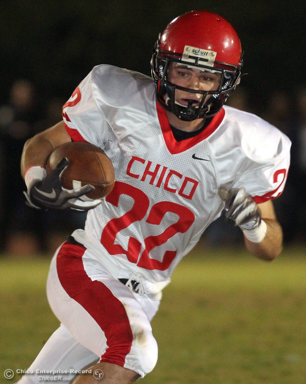 . Chico High\'s #22 Stefano Disano rushes against Pleasant Valley High in the first quarter during their Almond Bowl XLI football game at CSUC University Stadium Friday, October 21, 2011 in Chico, Calif. (Jason Halley/Chico Enterprise-Record)