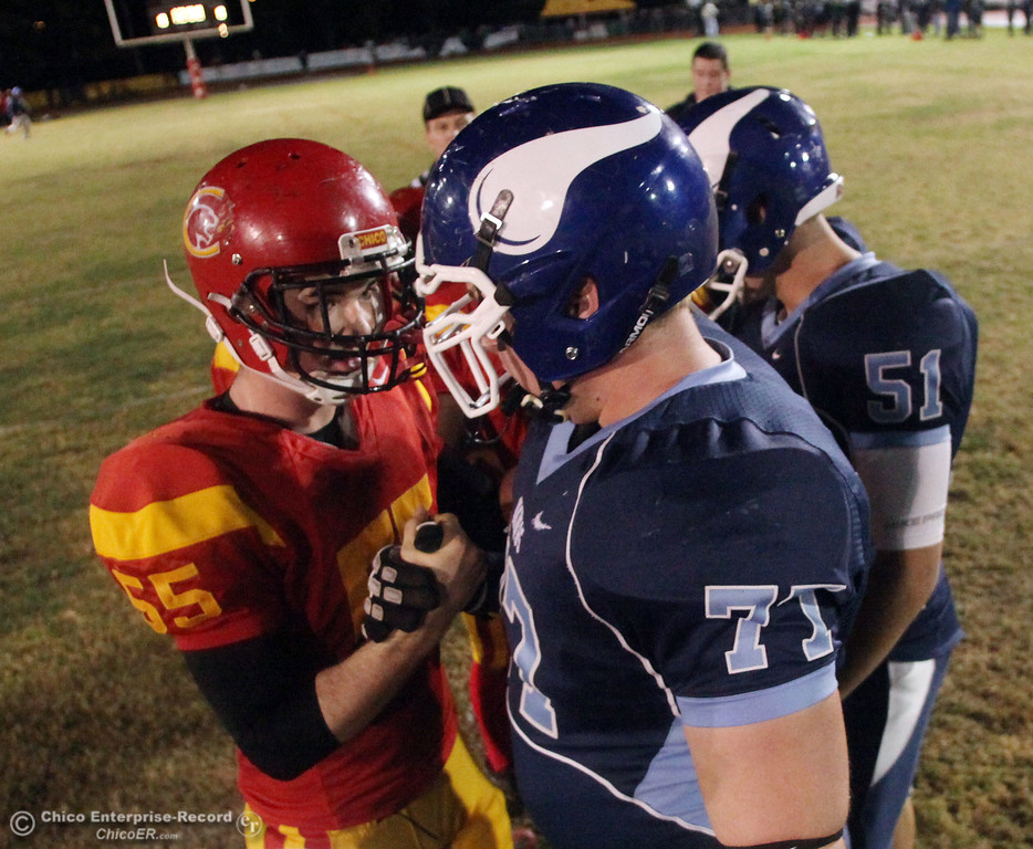 . Pleasant Valley High\'s #77 Jordan Rigsbee (right) against Chico High\'s #55 Weston Haight (left) in the first quarter of their Almond Bowl football game at CSUC University Stadium Friday, October 22, 2010 in Chico, Calif.