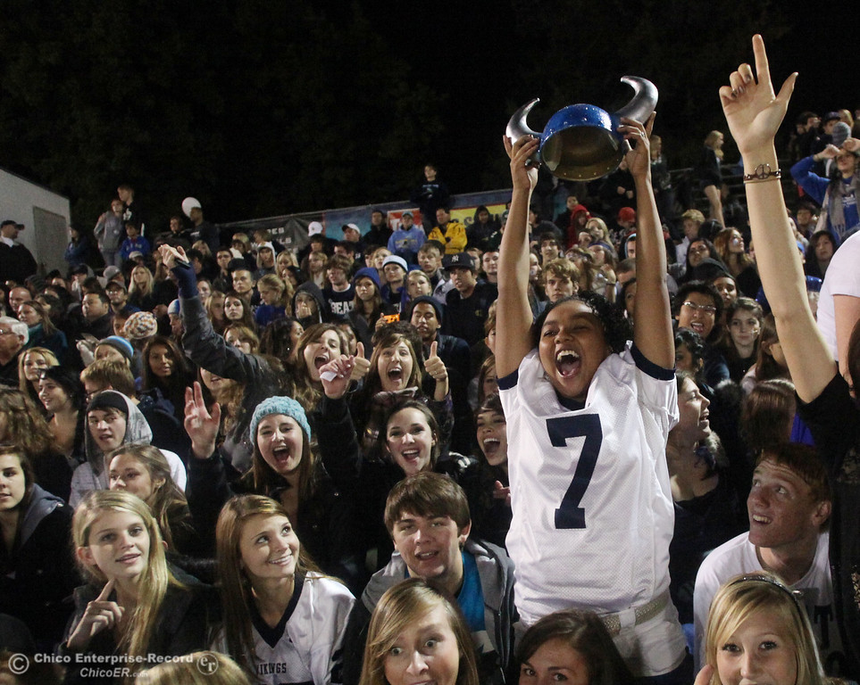 . Andshea Ray (right, wearing #7) cheers on Pleasant Valley High against Chico High in the second quarter of their Almond Bowl football game at CSUC University Stadium Friday, October 22, 2010 in Chico, Calif.