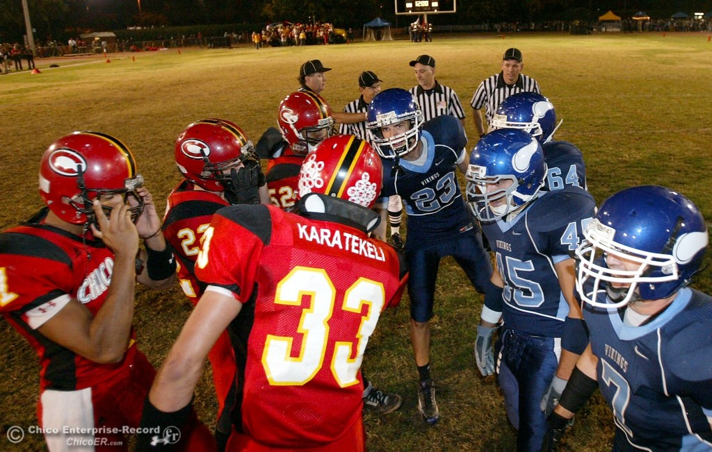 . Chico High against Pleasant Valley High shake hands for the coin toss in the first quarter of their 2008 Almond Bowl Football game Friday, October 17, 2008 at CSUC University Stadium in Chico, CA. 
