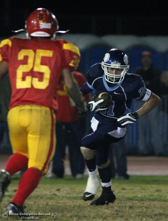 . Pleasant Valley High\'s #21 Darren Thomas (right) rushes against Chico High\'s #25 Ger Lee (left) in the second quarter of their Almond Bowl football game at CSUC University Stadium Friday, October 22, 2010 in Chico, Calif.