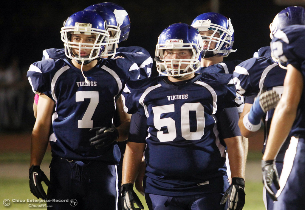 . Pleasant Valley\'s #7 Kyle Forbis (left) and #50 A.J. Harrod (right) ready against Chico High in the first quarter during their Almond Bowl XLI football game at CSUC University Stadium Friday, October 21, 2011 in Chico, Calif. (Jason Halley/Chico Enterprise-Record)