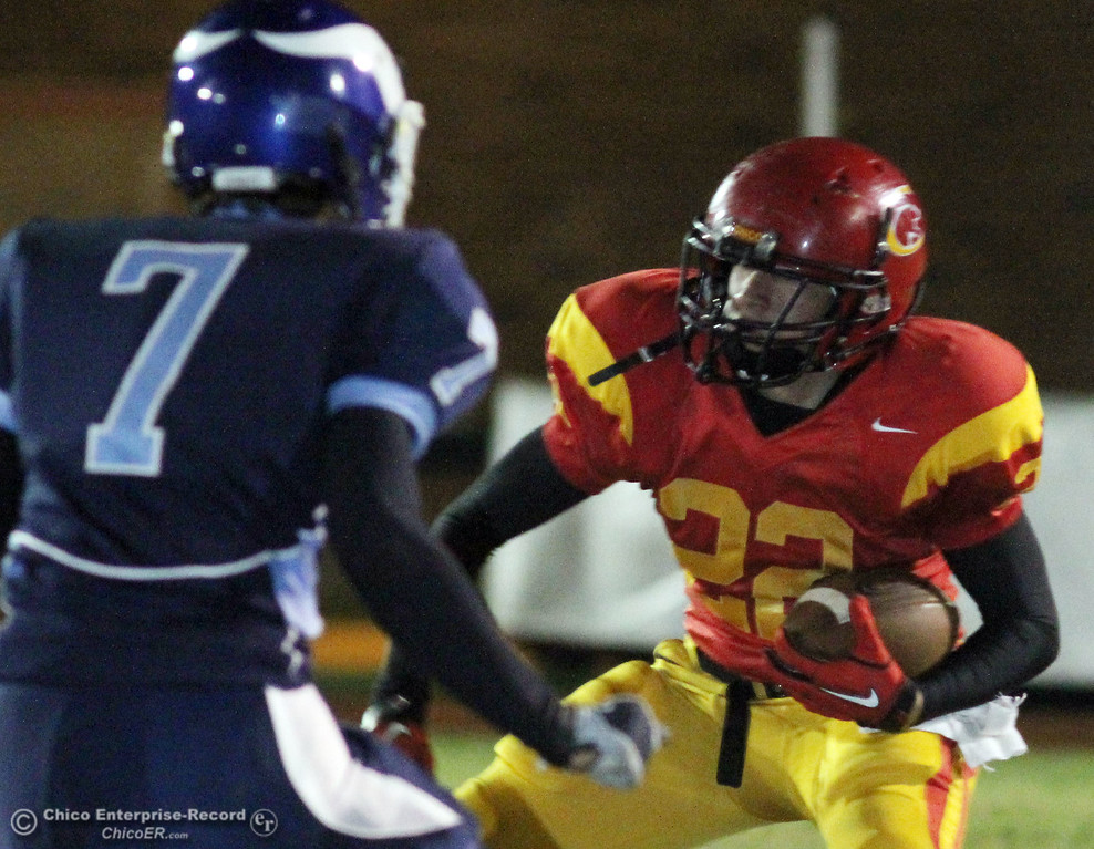 . Pleasant Valley High\'s #7 Kyle Forbis (left) defends against Chico High\'s #22 Jason Peck (right) in the first quarter of their Almond Bowl football game at CSUC University Stadium Friday, October 22, 2010 in Chico, Calif.