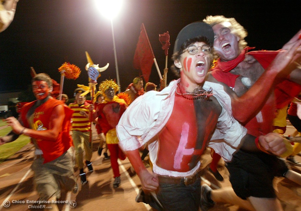 . Chico High fan Russell Rabut (center) charges through the track with other rowdy fans against Pleasant Valley High in the first quarter of their 2008 Almond Bowl Football game Friday, October 17, 2008 at CSUC University Stadium in Chico, CA. 