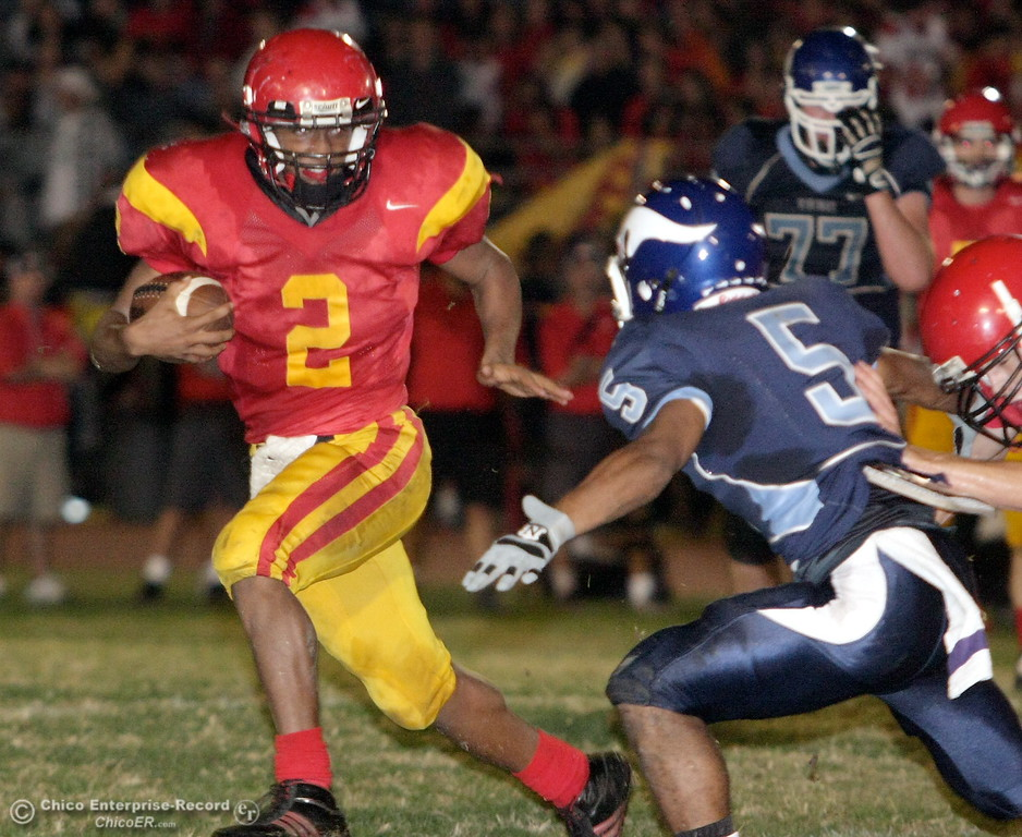 . Chico High\'s #2 Jamiel Hardman (left) is tackled against Pleasant Valley High\'s #5 Jerrick Wallace (right) in the first quarter of their Almond Bowl football game at CSUC University Stadium Friday, October 16, 2009 in Chico, Calif. (Jason Halley/Chico Enterprise-Record)