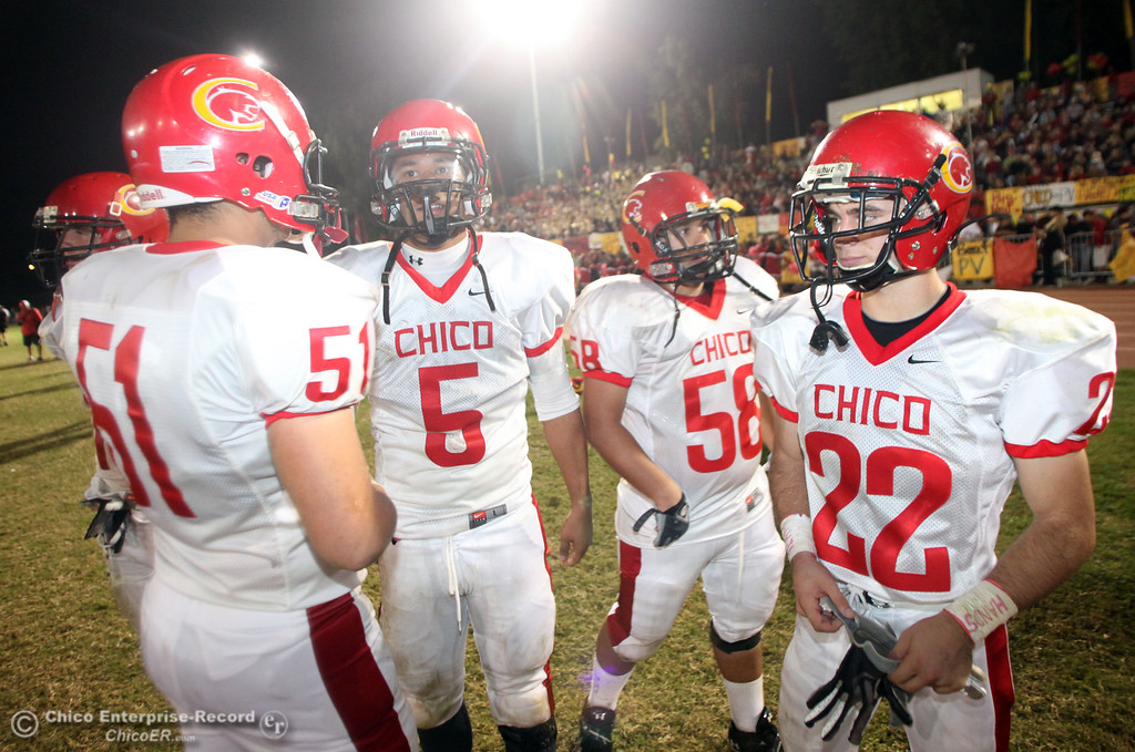 . Chico High\'s #51 Austin Hardesty, #5 Trevon Reid, #58 Caleb Akers and #22 Stefano Disano (left to right) against Pleasant Valley High in the fourth quarter during their Almond Bowl XLI football game at CSUC University Stadium Friday, October 21, 2011 in Chico, Calif. (Jason Halley/Chico Enterprise-Record)
