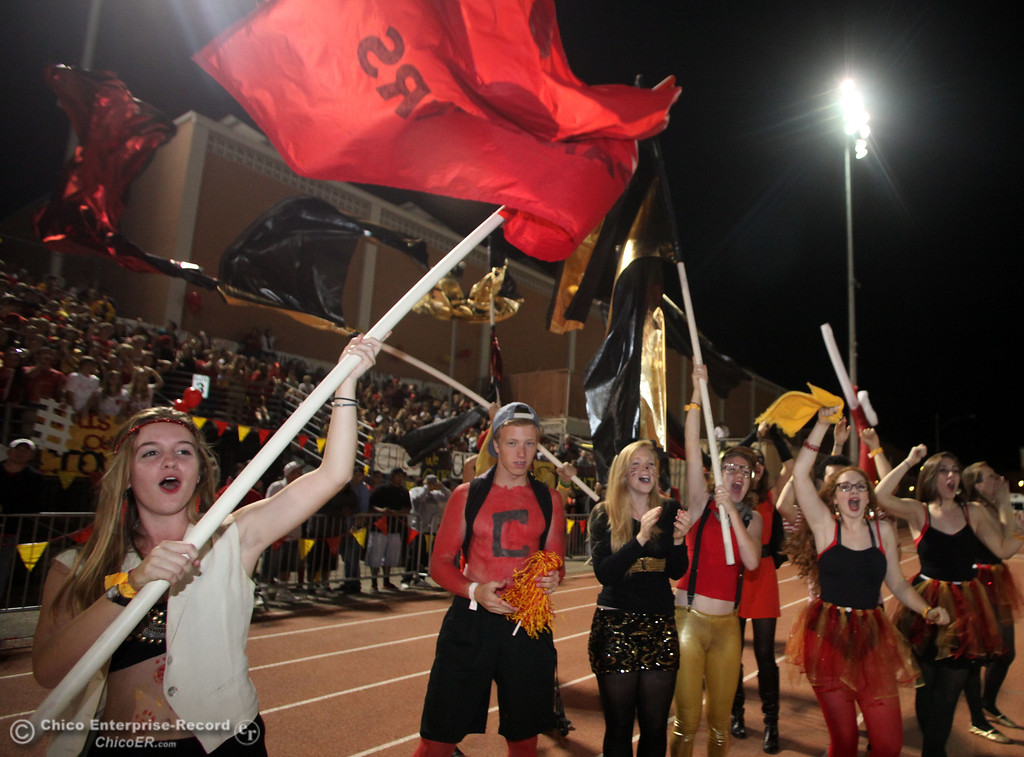 . Pleasant Valley against Chico High fans Ellen Jeffers, 16 (left) and others cheer on their team in the second quarter during their Almond Bowl XLI football game at CSUC University Stadium Friday, October 21, 2011 in Chico, Calif.