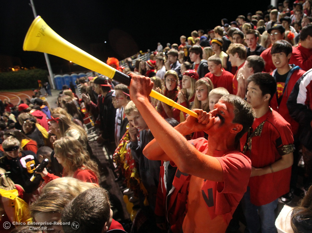 . Zach Korte, 17 (right) blows on a vuvuzela horn as he cheers for Chico High against Pleasant Valley High during the Almond Bowl football game at CSUC University Stadium Friday, October 22, 2010 in Chico, Calif.