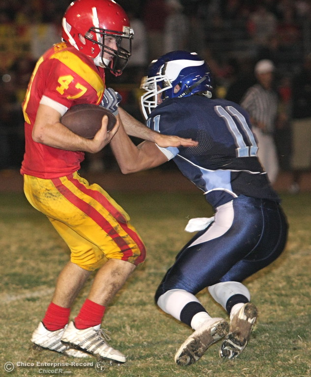 . Chico High\'s #47 Ian Boyer (left) rushes against Pleasant Valley High\'s #11 Gary Hemmingsen (right) in the second quarter of their Almond Bowl football game at CSUC University Stadium Friday, October 16, 2009 in Chico, Calif.
