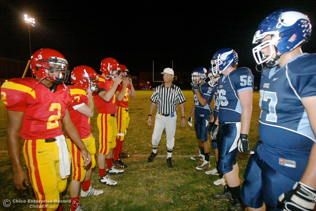 . Chico High\'s #2 Jamiel Hardman, #47 Ian Boyer, #7 Kyle Quackenbush, and #99 Jessen Cole against Pleasant Valley High\'s #2 Logan Valencia, #34 Joey Ruth, #56 Kenny Young, and #77 Jordan Rigsbee (left to right) walk onto the field for the coin toss in the first quarter of their Almond Bowl football game at CSUC University Stadium Friday, October 16, 2009 in Chico, Calif. (Jason Halley/Chico Enterprise-Record)