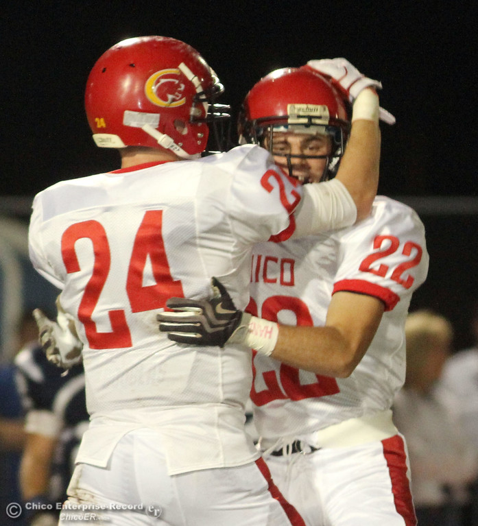 . Chico High\'s #24 Kyle Twisselman (left) celebrates with #22 Stefano Disano (right) against Pleasant Valley High in the first quarter during their Almond Bowl XLI football game at CSUC University Stadium Friday, October 21, 2011 in Chico, Calif. (Jason Halley/Chico Enterprise-Record)