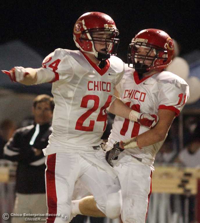 . Chico High\'s #24 Kyle Twisselman (left) celebrates with #11 Jesse Holmes (right) against Pleasant Valley High in the second quarter during their Almond Bowl XLI football game at CSUC University Stadium Friday, October 21, 2011 in Chico, Calif. (Jason Halley/Chico Enterprise-Record)