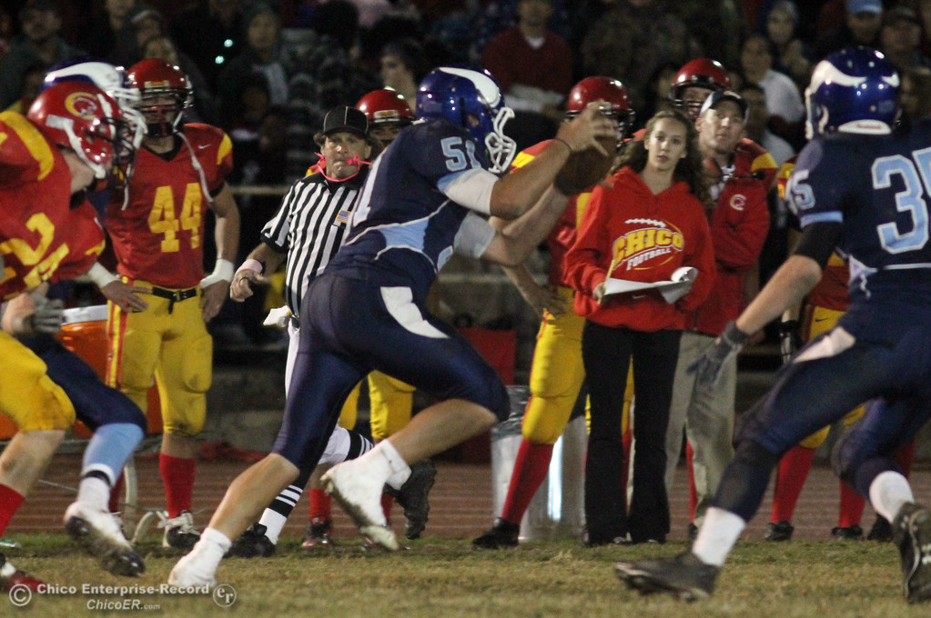 . Pleasant Valley High\'s #51 Sean Oshea (center) nabs an interception against Chico High in the second quarter of their Almond Bowl football game at CSUC University Stadium Friday, October 22, 2010 in Chico, Calif.