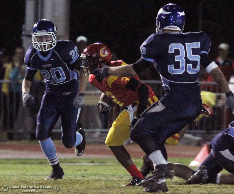 . Pleasant Valley High\'s #20 Shane Wallen (left) and #35 Austin Rozzanno (right) defend against Chico High\'s #3 Vince Allen (center) who rushes in the second quarter of their Almond Bowl football game at CSUC University Stadium Friday, October 22, 2010 in Chico, Calif.