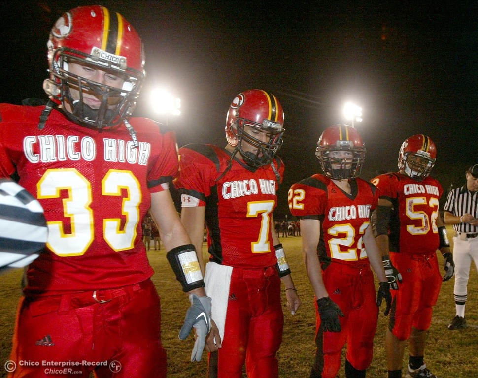 . Chico High\'s #33 Kayhan Karatekeli, #7 Nate Anderson, #22 Austin Somhegyi, and #52 Anthony Jones ready to take the coin toss against Pleasant Valley High in the first quarter of their 2008 Almond Bowl Football game Friday, October 17, 2008 at CSUC University Stadium in Chico, CA. 