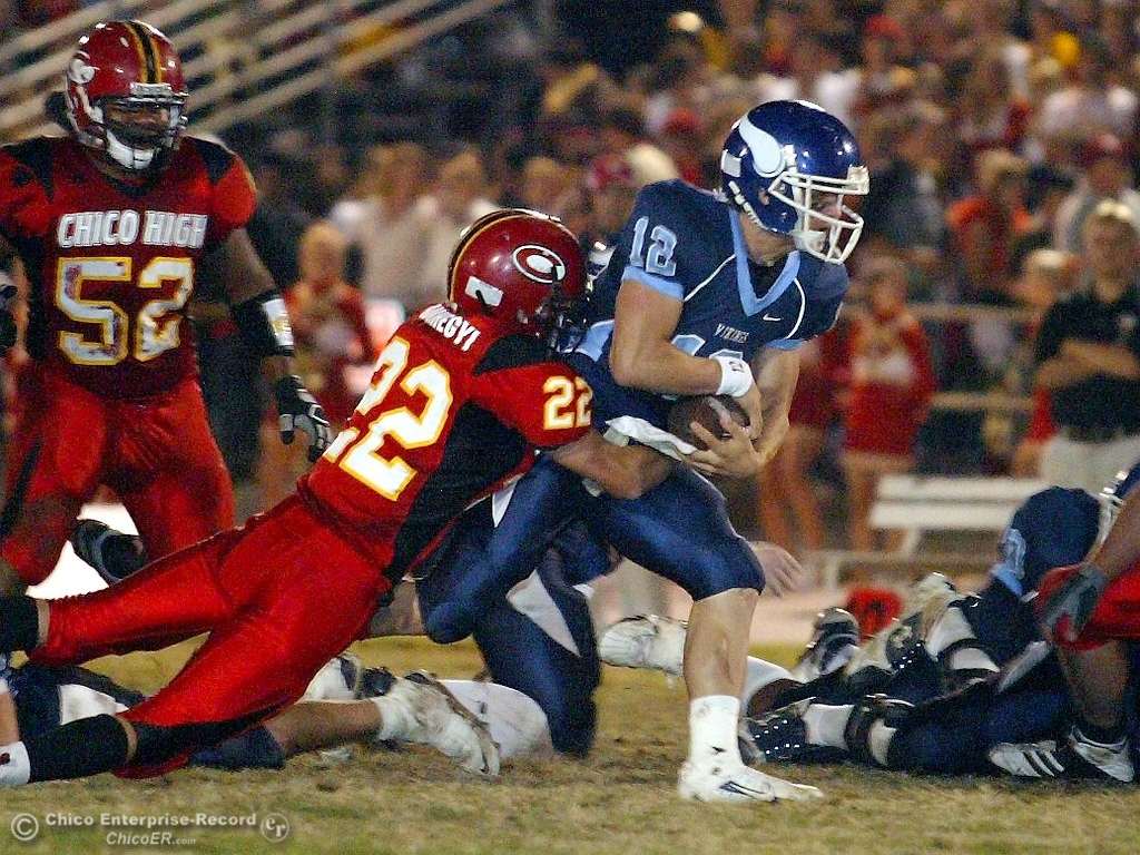 . Chico High\'s #22 Austin Somhegyi (left) tackles against Pleasant Valley High\'s #12 Patrick Randolph (right) in the first quarter of their 2008 Almond Bowl Football game Friday, October 17, 2008 at CSUC University Stadium in Chico, CA. 