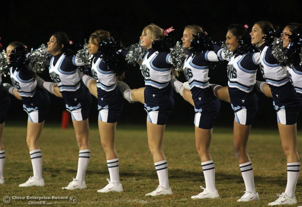 . Pleasant Valley High cheerleaders to a routine against Chico High in the first quarter of their Almond Bowl football game at CSUC University Stadium Friday, October 22, 2010 in Chico, Calif.