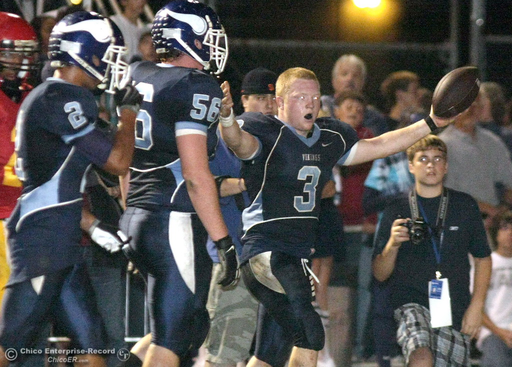 . Pleasant Valley High\'s #3 Ryan Powers (right) has his helmet knocked off against Chico High in the first quarter of their Almond Bowl football game at CSUC University Stadium Friday, October 16, 2009 in Chico, Calif. (Jason Halley/Chico Enterprise-Record)