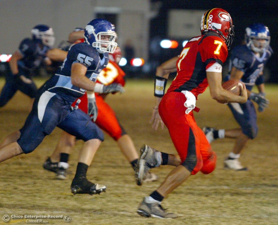 . Chico High\'s #7 Nate Anderson (right) rushes against Pleasant Valley High\'s #55 Danny Andreasen (left) in the first quarter of their 2008 Almond Bowl Football game Friday, October 17, 2008 at CSUC University Stadium in Chico, CA. 