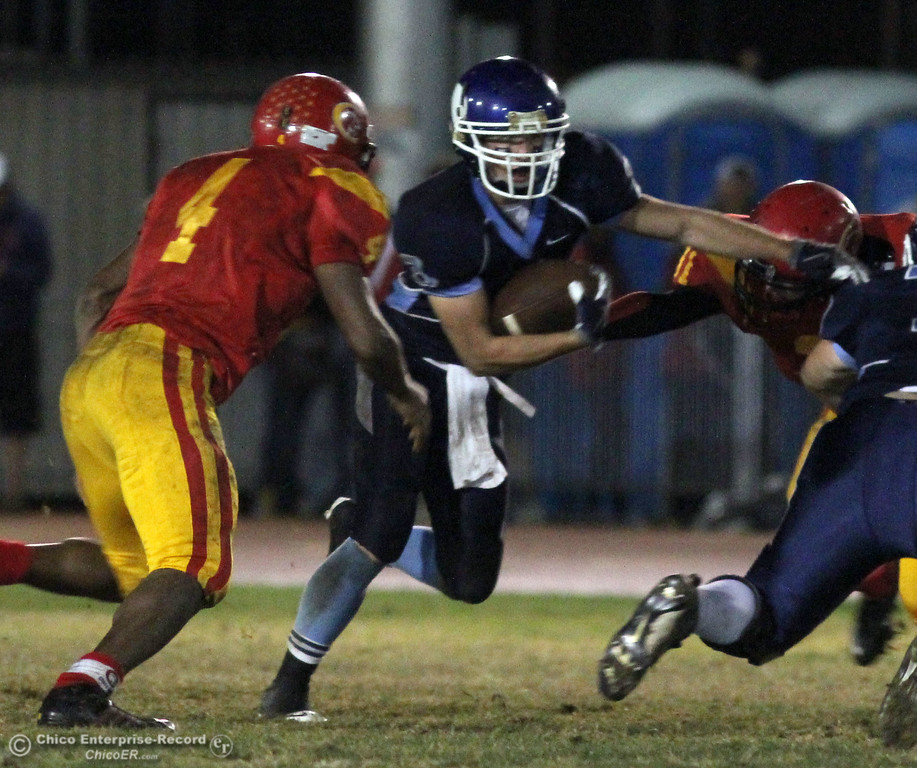 . Pleasant Valley High\'s #3 Gary Hemmingsen (right) rushes against Chico High\'s #4 Jamiel Hardman (left) in the second quarter of their Almond Bowl football game at CSUC University Stadium Friday, October 22, 2010 in Chico, Calif.