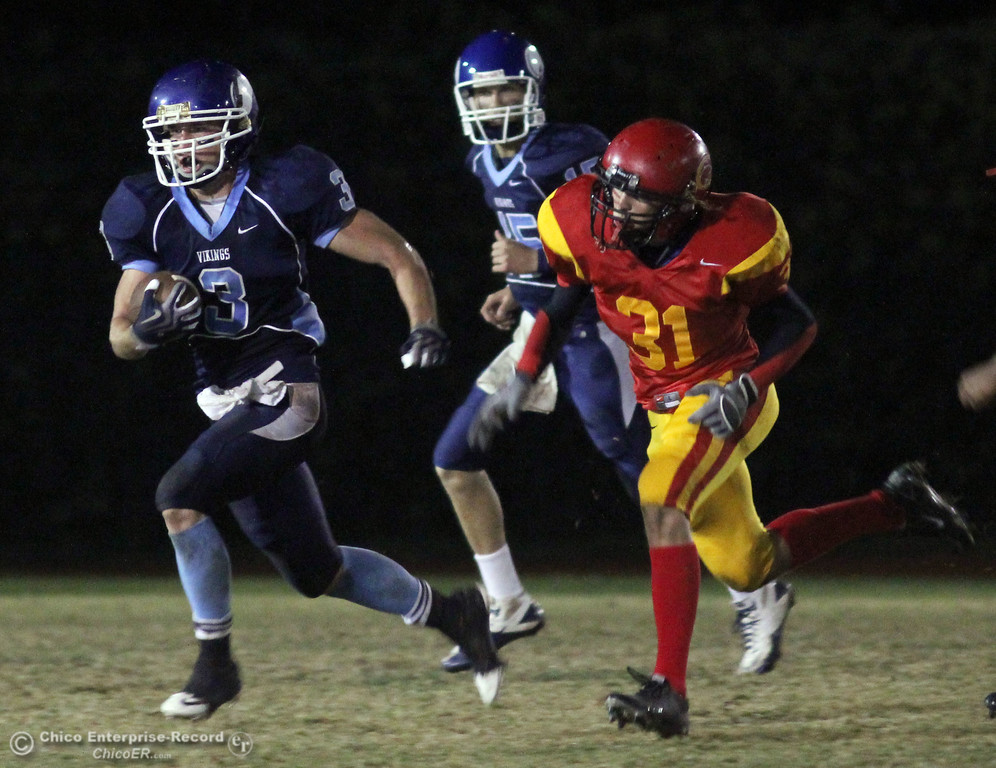 . Pleasant Valley High\'s #3 Gary Hemmingsen (left) rushes against Chico High\'s #31  (right) in the second quarter of their Almond Bowl football game at CSUC University Stadium Friday, October 22, 2010 in Chico, Calif.