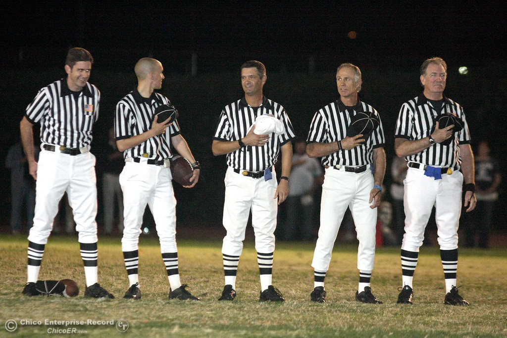 . The referees Chico High against Pleasant Valley High in the first quarter of their Almond Bowl football game at CSUC University Stadium Friday, October 16, 2009 in Chico, Calif. (Jason Halley/Chico Enterprise-Record)