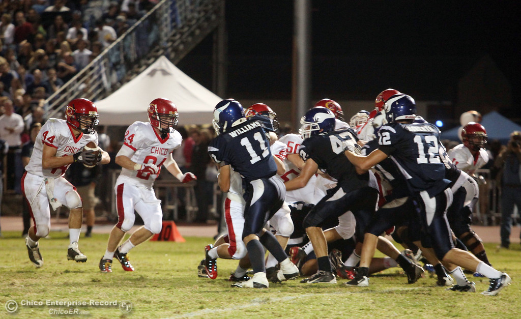 . Chico High\'s #44 Mark Jorgensen (left) rushes against Pleasant Valley High in the second quarter during their Almond Bowl XLI football game at CSUC University Stadium Friday, October 21, 2011 in Chico, Calif. (Jason Halley/Chico Enterprise-Record)