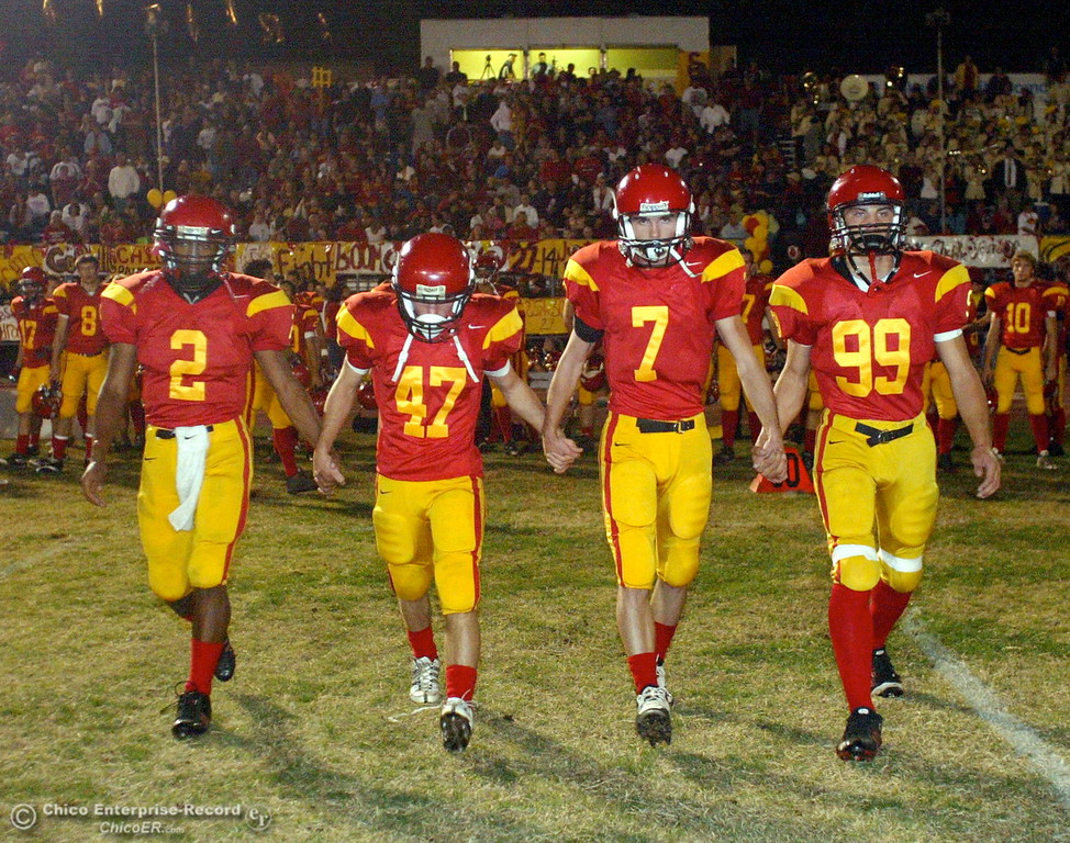 . Chico High\'s #2 Jamiel Hardman, #47 Ian Boyer, #7 Kyle Quackenbush, and #99 Jessen Cole (left to right) walk onto the field for the coin toss against Pleasant Valley High in the first quarter of their Almond Bowl football game at CSUC University Stadium Friday, October 16, 2009 in Chico, Calif. (Jason Halley/Chico Enterprise-Record)