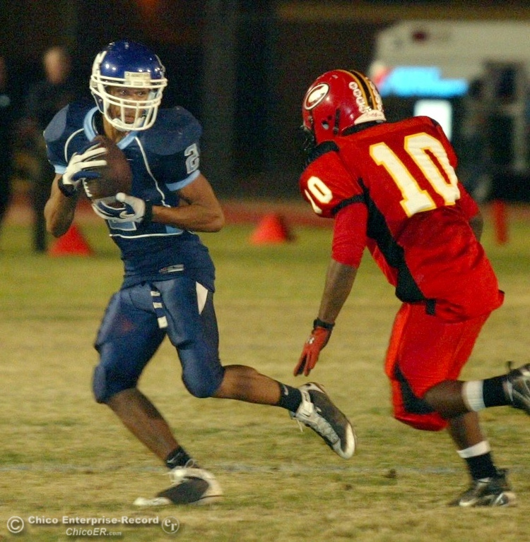 . Chico High\'s #10 Charles Robinson (right) moves against Pleasant Valley High\'s #2 Logan Valencia (left) in the first quarter of their 2008 Almond Bowl Football game Friday, October 17, 2008 at CSUC University Stadium in Chico, CA. 