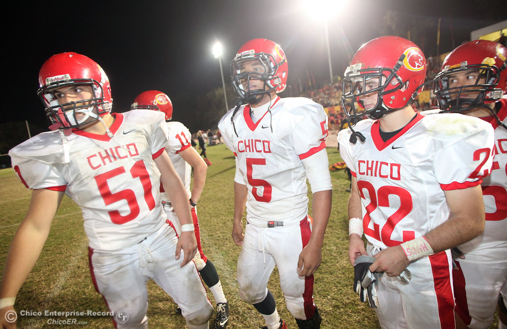 . Chico High\'s #51 Austin Hardesty, #5 Trevon Reid, and #22 Stefano Disano (left to right) against Pleasant Valley High in the fourth quarter during their Almond Bowl XLI football game at CSUC University Stadium Friday, October 21, 2011 in Chico, Calif. (Jason Halley/Chico Enterprise-Record)