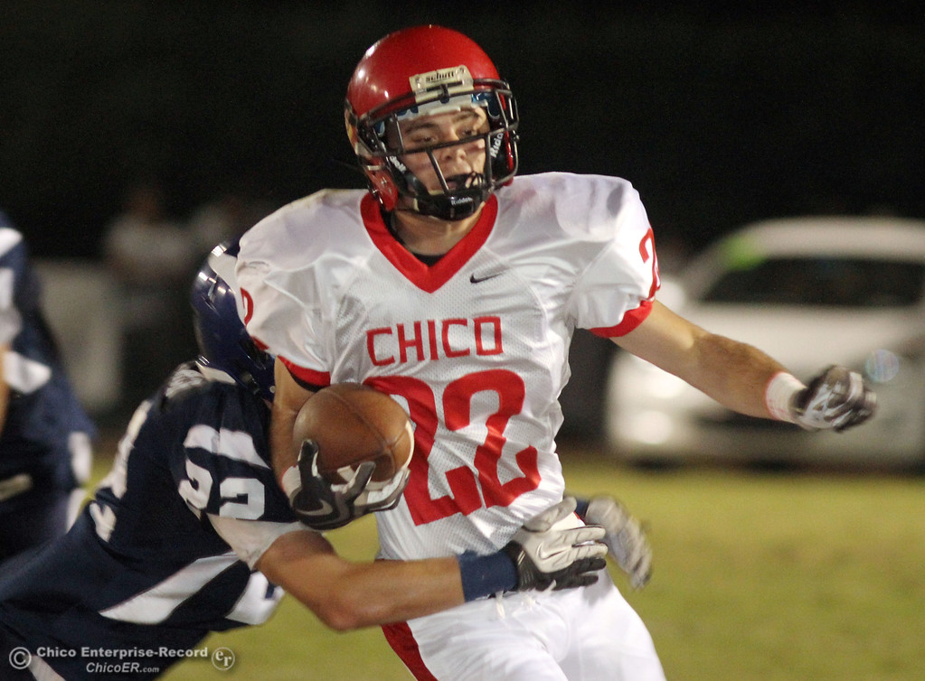 . Chico High\'s #22 Stefano Disano (right) is tackled against Pleasant Valley High\'s #22 Michael Gerlach (left) in the first quarter during their Almond Bowl XLI football game at CSUC University Stadium Friday, October 21, 2011 in Chico, Calif.