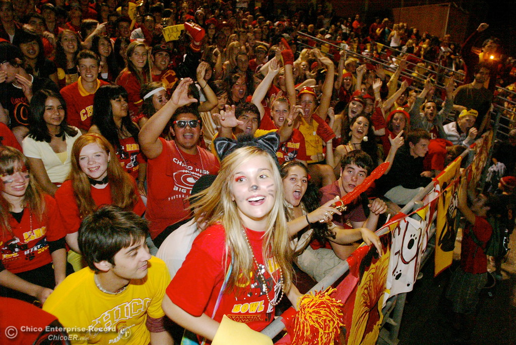 . Hannah Kuiper, 17 (front) cheers with fans of Chico High against Pleasant Valley High in the first quarter of their Almond Bowl football game at CSUC University Stadium Friday, October 16, 2009 in Chico, Calif. (Jason Halley/Chico Enterprise-Record)
