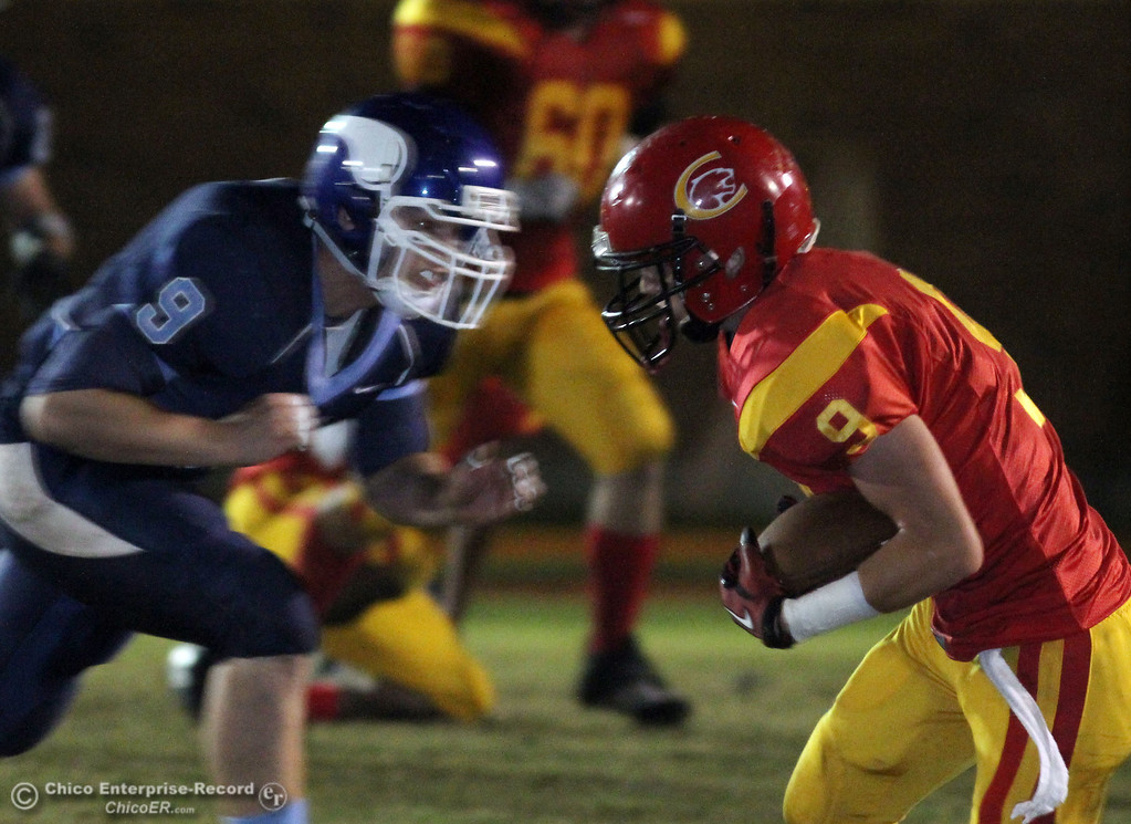 . Pleasant Valley High\'s #9 Casey Reynolds (left) tackles against Chico High\'s #9 Jesse Holmes (right) in the first quarter of their Almond Bowl football game at CSUC University Stadium Friday, October 22, 2010 in Chico, Calif.