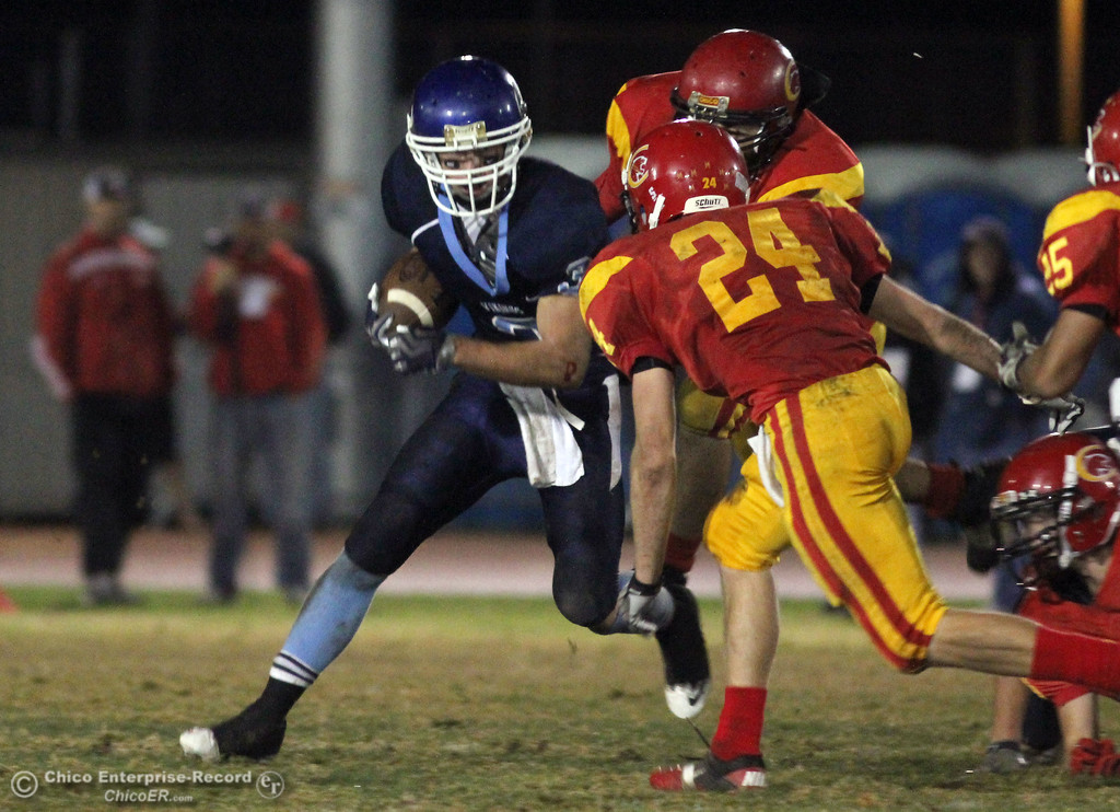 . Pleasant Valley High\'s #3 Gary Hemmingsen (left) rushes against Chico High\'s #24 Kyle Twisselman (right) in the second quarter of their Almond Bowl football game at CSUC University Stadium Friday, October 22, 2010 in Chico, Calif.
