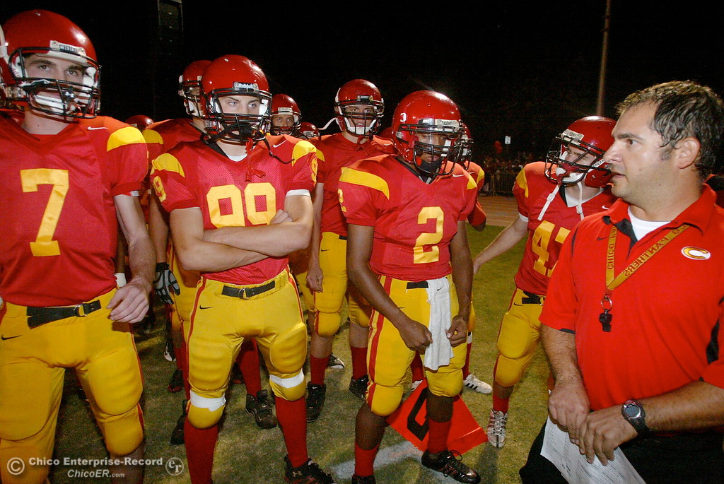 . Chico High\'s #7 Kyle Quackenbush, #9 9Jessen Cole, #2 Jamiel Hardman, and #47 Ian Boyer with coach Jason __ (left to right) come onto the field against Pleasant Valley High in the first quarter of their Almond Bowl football game at CSUC University Stadium Friday, October 16, 2009 in Chico, Calif. (Jason Halley/Chico Enterprise-Record)