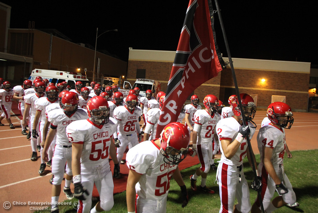 . Chico High\'s team takes the field against Pleasant Valley before the first quarter during their Almond Bowl XLI football game at CSUC University Stadium Friday, October 21, 2011 in Chico, Calif. (Jason Halley/Chico Enterprise-Record)