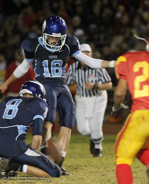 . Pleasant Valley High\'s #16 Brody Hill (top) kicks the extra point that was no good against Chico High in the second quarter of their Almond Bowl football game at CSUC University Stadium Friday, October 22, 2010 in Chico, Calif.